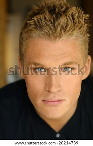 Close-up portrait of young male model in black shirt - stock photo