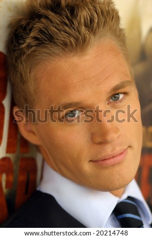 Close-up portrait of young male model in tie - stock photo