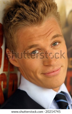 Close-up portrait of young male model with slight smile - stock photo