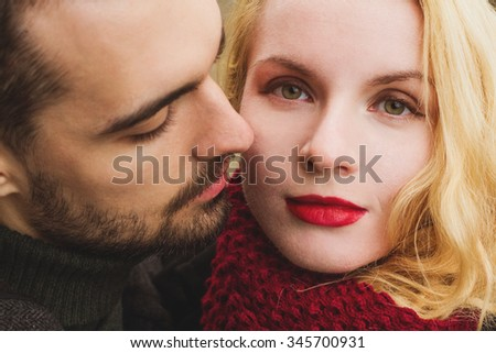 close up portrait of young man and woman. - stock photo