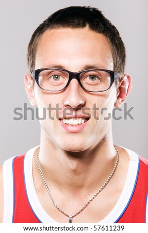 Close up portrait of young man in glasses - stock photo