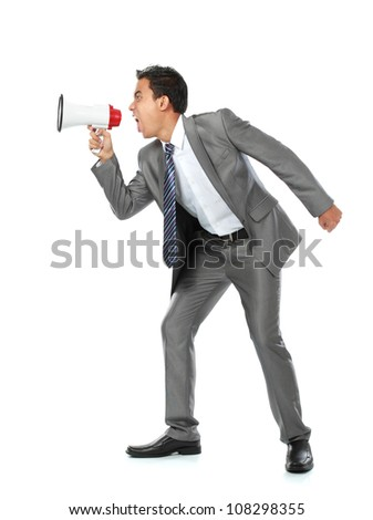 close up portrait of young man shouting using megaphone isolated on white background - stock photo