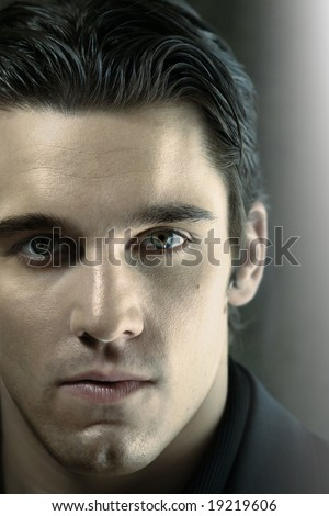 Close up portrait of young man staring into the lens - stock photo