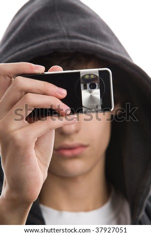Close-up portrait of young man wearing hooded sweatshirt taking a picture using phone camera - stock photo