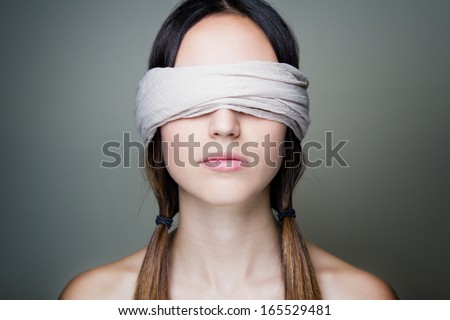 Close-up portrait of young Naked blindfold woman - stock photo