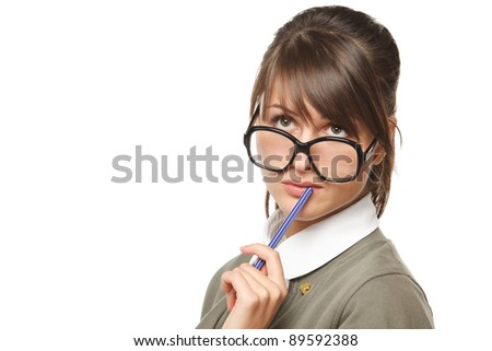 Close-up portrait of young pensive female wearing old fashioned eyeglasses looking up, isolated on white background - stock photo