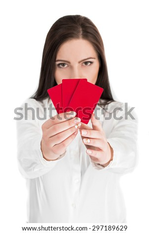 Close-up portrait of young pretty business woman holding red credit card isolated on white background.  focus on the credit card - stock photo