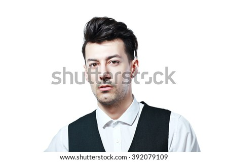 close up portrait of young serious man on the white background looking at camera - stock photo