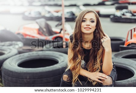 Close up portrait of young sexy gorgeous attractive woman with long beauty hair have a good time outdoor in summer on carting. Beauty, fashion, sport concept
