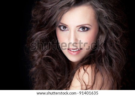 close-up portrait of young smiling brunette, shallow DOF, clear focus on model's eye