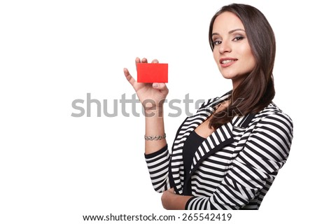 Close-up portrait of young smiling business woman holding credit card isolated on white - stock photo