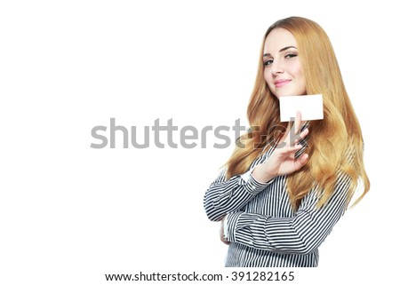 Close-up portrait of young smiling business woman holding credit card isolated on white background - stock photo