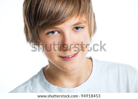 Close up portrait of young smiling cute teenager in white, isolated on white