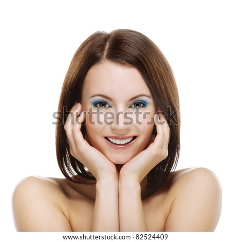 Close-up portrait of young smiling dark-haired woman propping up her face against white background. - stock photo