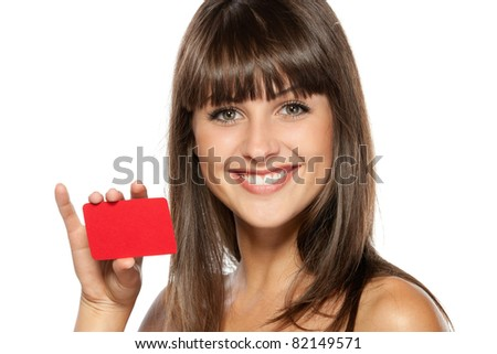 Close-up portrait of young smiling female holding credit card isolated on white background - stock photo