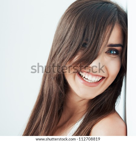 Close up portrait of Young smiling woman. - stock photo