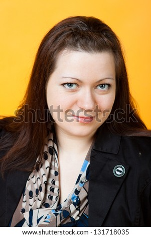 close-up portrait of young smiling woman - stock photo