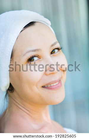 Close up portrait of young smiling woman with a hat towel , are home  - stock photo