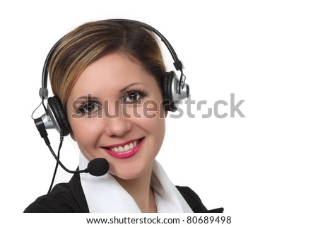 Close-up portrait of young smiling women with  headset on white background - stock photo