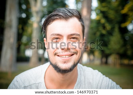 close up portrait of young stylish man smiling