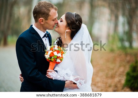Close up portrait of young wedding couple at the moment for a kiss