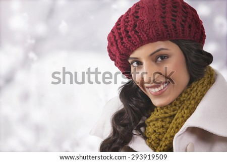 Close-up portrait of young woman in warm clothes