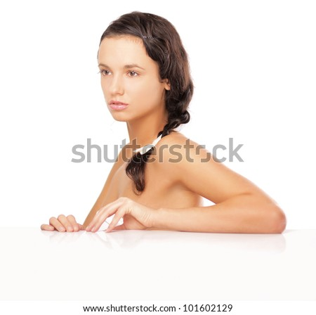 Close-up portrait of young woman isolated on white background - stock photo