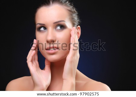 Close-up portrait of young woman model with glamour make-up - stock photo