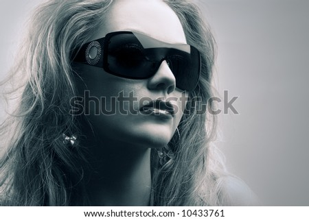 close up portrait of young woman wearing sunglasses - stock photo