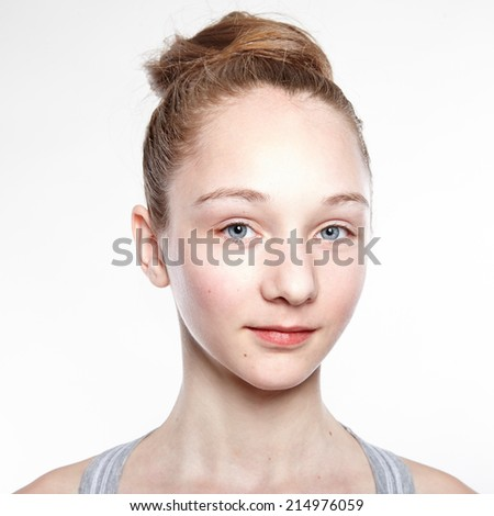 Close-up portrait of young woman with beautiful blue eyes. On white background