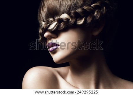 close-up portrait of young woman with creative hairstyle - stock photo