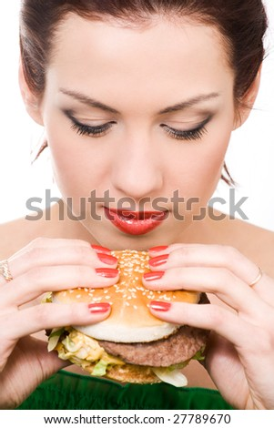 close-up portrait of young woman with hamburger