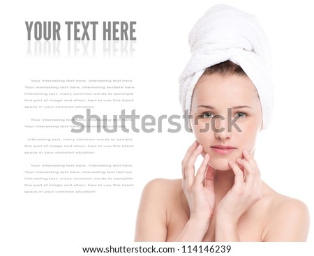 Close-up portrait of young woman with perfect health skin of face and bath towel on head. Isolated on white