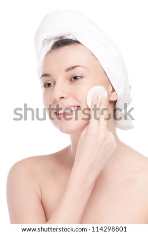 Close-up portrait of young woman with perfect health skin of face and bath towel on head. Isolated on white - stock photo