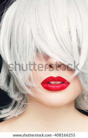 Close-up portrait of young woman with red lipstick and manga haircut - stock photo