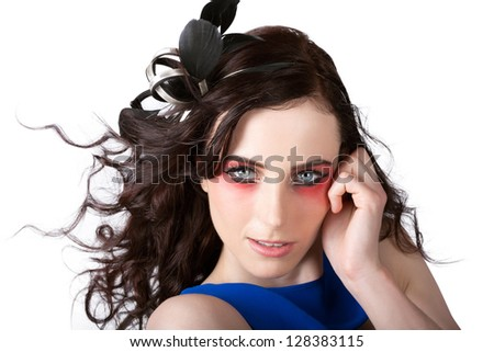 Close Up Portrait On The Face Of A Romantic Model With Beautiful Red Eye Makeup And Wavy Hairstyle - stock photo