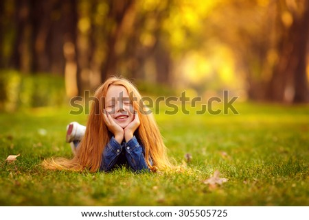 close-up portrait. Pretty red-haired girl in the autumn park. emotion. emotional portrait - stock photo