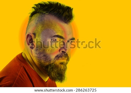 close-up portrait profile of a angry white man with mohawk and beard instagram filter