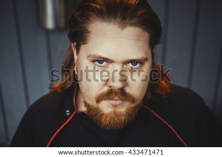 close-up portrait red-haired Scandinavian man with a beard and long hair in the form of a chef brutal manly attractive - stock photo