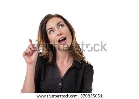 Close up portrait shot of a pretty business woman smiling, thinking and looking up - stock photo