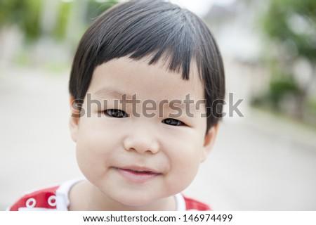 Close up portrait smiling Thailand boy (Asian boy)  - stock photo