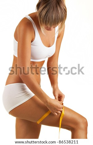 Close up portrait woman body with measurement ribbon - stock photo