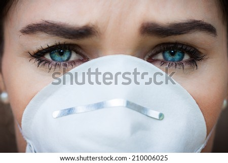 Close-up portrait woman wearing a face mask - stock photo