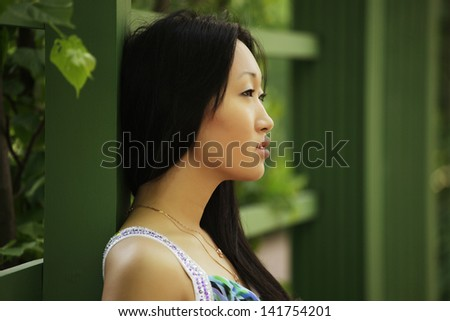 close up portrait young asian woman outdoor - stock photo