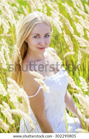Close up Portrait, Young beautiful blonde woman posing outdoors in summer green park - stock photo