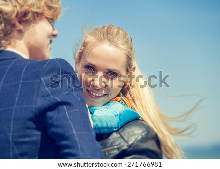 Close up portrait young couple at the seaside - stock photo