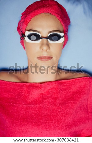 Close up portrait young woman lying on the table in medical cabinet for procedure - stock photo