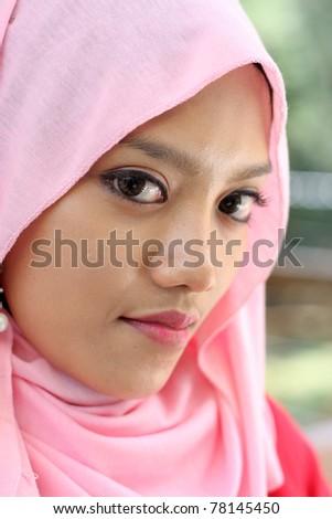 close up portraits of beautiful muslim girl - stock photo