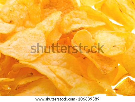 Close-up potato chips to background - stock photo
