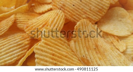 Close up potato chips top view background